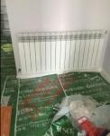 无锡明装暖气片无锡地区适合地暖还是暖气片